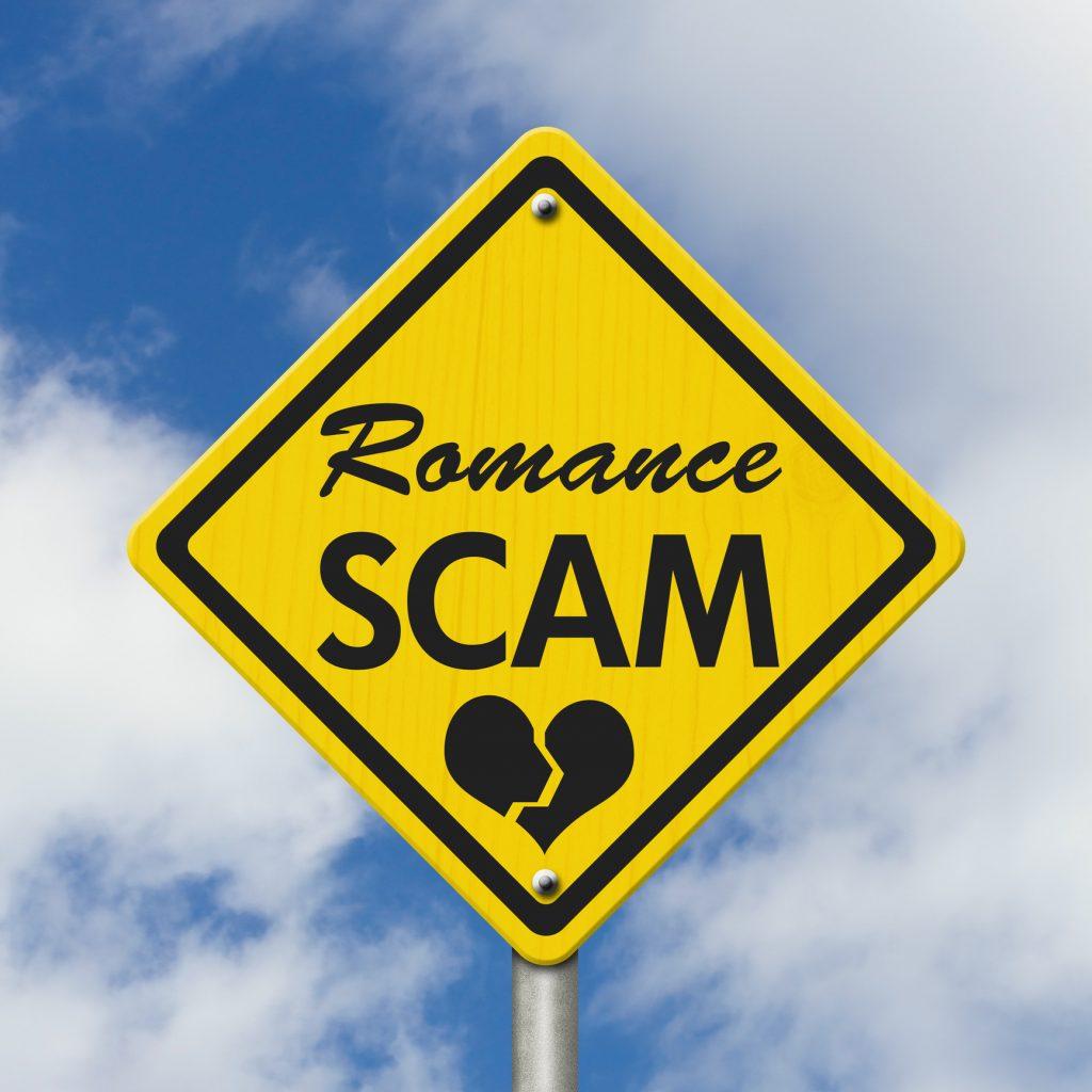 Gelbes Warnschild welches vor Romance-Scammern warnt