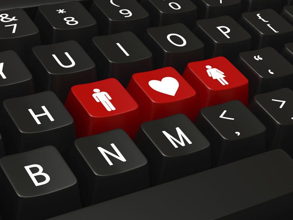 Tastaturausschnitt mit 3 Tasten in rot, die einen Mann eine Frau und ein Herz zeigen